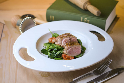Duck breast salad with bok choy leaves and truffle dressing